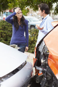 Two Drivers Inspecting Damage After Traffic Accident