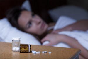 Sleeping pills lying on night table